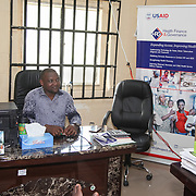 INDIVIDUAL(S) PHOTOGRAPHED: Ibiam Azu Agwu. LOCATION: Family Health Clinic, Moor Road, Calabar, Cross River, Nigeria. CAPTION: Ibiam Azu Agwu, pictured here in his office in Calabar, manages the HFG Project in Cross River.