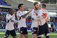 Bolton Wanderer's Joe Mason celebrates with his teammates  after scoring his sides second goal. Skybet championship match, Bolton Wanderers v Blackburn Rovers at the Reebok Stadium in Bolton, England on Saturday 1st March 2014.<br /> pic by David Richards, Andrew Orchard sports photography.