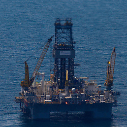 The Transocean Development Driller III is preparing to resume drilling a relief at the BP Plc MC252 well site in the Gulf of Mexico off the coast of Louisiana, U.S., on Monday, July 26, 2010. BP Plc is now preparing their 'static kill' option that involves pumping mud into the well to force oil back into the reservoir below. Photographer: Derick E. Hingle/Bloomberg