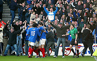 Photo: Scott Heavey.<br /> Portsmouth v Southampton. FA Barclaycard Premeirship. 21/03/2004.<br /> The Portsmouth fans invade the pitch after taking the lead