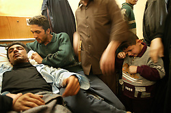 Policeman Amir Abdul Khadar, 29, is comforted by relatives at the local hospital, Iskandariyah, Iraq, Feb. 10, 2004. Khaled sustained injuries when a truck packed with an estimated 500 pounds of explosives blew up at a police station. Dozens of would-be recruits were lined up to apply for jobs at the station. A hospital official said at least 50 people were killed and 50 others wounded.
