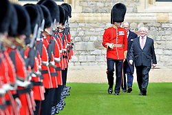 © Licensed to London News Pictures. 08/04/2014. Windsor, UK. Michael D Higgins and HRH Prince Philip inspect the troops. Irish President Michael D Higgins has arrived in Britain for his country's first ever visit by a head of state. He was taken to Windsor Castle in a royal coach to meet the Queen and Prince Philip where he inspected the 1st Battalion Grenadier Guards in the Quadrangle at Windsor Castle. Photo credit : Sergeant Steve Blake/LNP