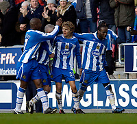 Photo: Jed Wee.<br />Wigan Athletic v Arsenal. The Barclays Premiership.<br />19/11/2005.<br />Wigan celebrate with goalscorer Jimmy Bullard.