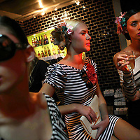 Israeli models rest behind the scenes before a fashion show in Tel Aviv.
