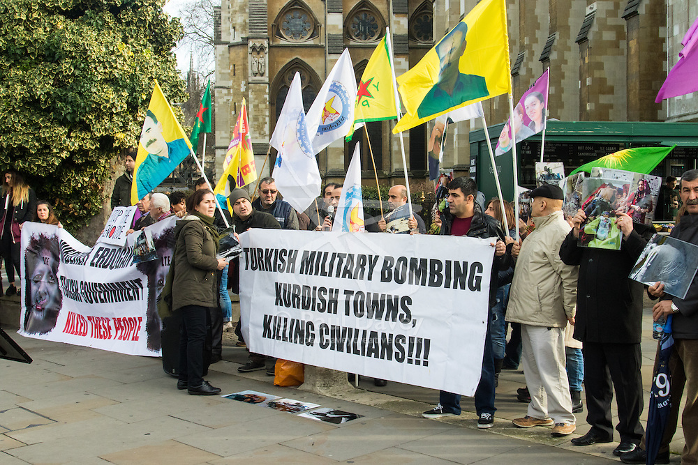 """Queen Elizabeth II Conference Centre, Westminster, February 4th 2016. Dozens of Kurds demonstrate outside the Supporting Syria conferencee, protesting against the presence of Turkish Prime Minister Ahmet Davutoglu and Britain's support for Turkey, which they accuse of being a """"Terrorist State"""". ///FOR LICENCING CONTACT: paul@pauldaveycreative.co.uk TEL:+44 (0) 7966 016 296 or +44 (0) 20 8969 6875. ©2015 Paul R Davey. All rights reserved."""