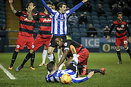 Nedum Onuoha (C) (QPR) looks on as Gary Hooper (Sheffield Wednesday) goes to ground in the penalty box. The Sheffield Wednesday players claim a penalty. The referee awards them one during the Sky Bet Championship match between Sheffield Wednesday and Queens Park Rangers at Hillsborough, Sheffield, England on 23 February 2016. Photo by Mark P Doherty.
