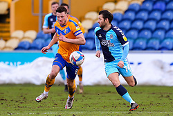 Ollie Clarke of Mansfield Town chases down Wes Hoolahan of Cambridge United - Mandatory by-line: Ryan Crockett/JMP - 20/02/2021 - FOOTBALL - One Call Stadium - Mansfield, England - Mansfield Town v Cambridge United - Sky Bet League Two