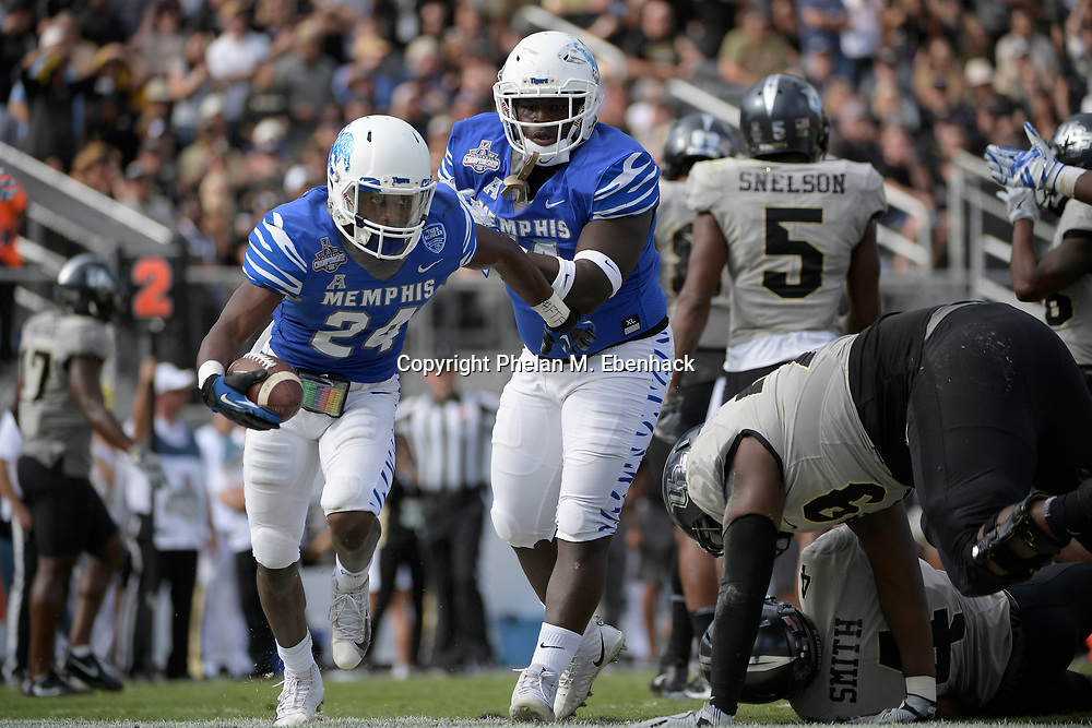 Memphis defensive back Tito Windham (24) celebrates after intercepting a pass during the first half of the American Athletic Conference championship NCAA college football game against Central Florida Saturday, Dec. 2, 2017, in Orlando, Fla. (Photo by Phelan M. Ebenhack)