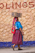 A Zapotec woman in traditional costume at the Sunday market in Tlacolula de Matamoros, Mexico. The regional street market draws thousands of sellers and shoppers from throughout the Valles Centrales de Oaxaca.