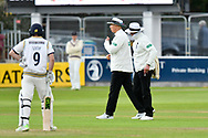 Bad Light Stops Play - Umpires Mike Burn and Alex Wharf offer the light to the Yorkshire Batsmen during the third day of the Specsavers County Champ Div 1 match between Somerset County Cricket Club and Yorkshire County Cricket Club at the Cooper Associates County Ground, Taunton, United Kingdom on 29 April 2018. Picture by Graham Hunt.
