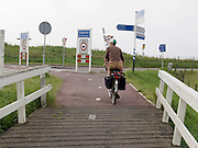 woman bicycling Holland