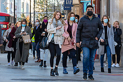 © Licensed to London News Pictures. 04/11/2020. London, UK. People wearing face masks on Oxford Street on the final day before non-essential show will close for a second lockdown. The government has announced a new national lockdown for England starting on Thursday 5th November and lasting for a month. Photo credit: Rob Pinney/LNP