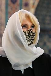 © Licensed to London News Pictures. 07/04/2021. London, UK. Camilla, Duchess of Cornwall, wearing a protective face covering and headscarf, in the Prayer Hall  during a visit to the London Islamic Cultural Society and Mosque (also known as Wightman Road Mosque) in Haringey, north London. The Mosque was formed by a small group of Guyanese Muslims and now supports over 30 different nationalities and community in Haringey and surrounding boroughs. Photo credit: Dinendra Haria/LNP