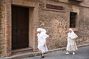 Roman Catholic nuns wearing traditional habit on their way to Mass in Segovia, Spain