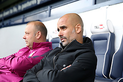 Manchester City manager Pep Guardiola in the dugout