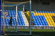 Hull City goalkeeper Matt Ingram (13) diving during the EFL Sky Bet League 1 match between AFC Wimbledon and Hull City at Plough Lane, London, United Kingdom on 27 February 2021.
