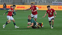Rugby Union - 2021 British & Irish Lions Tour of South Africa - Second Test: South Africa vs British & Irish Lions<br /> <br /> Pieter Steph du Toit is tackled as (l-r) Conor Murray, Tadhg Furlong and Tom Curry move in, at Cape Town Stadium, Cape Town.<br /> <br /> COLORSPORT / JOHAN ORTON