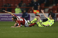 Nottingham Forest midfielder David Vaughan (24) fouls Brighton winger, Jamie Murphy (15)  during the Sky Bet Championship match between Nottingham Forest and Brighton and Hove Albion at the City Ground, Nottingham, England on 11 April 2016. Photo by Simon Davies.
