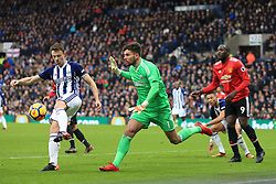 17th December 2017 - Premier League - West Bromwich Albion v Manchester United - West Brom goalkeeper Ben Foster shouts for the ball as teammate Jonny Evans clears it with Romelu Lukaku of Man Utd looming - Photo: Simon Stacpoole / Offside.