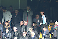 Arsene Wenger, the Arsenal manager listening on his earpiece in the stands. Premier league match, Chelsea v Arsenal at Stamford Bridge in London on Saturday 4th February 2017.<br /> pic by John Patrick Fletcher, Andrew Orchard sports photography.