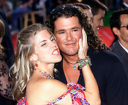 Latin music star Carlos Vives (R) receives a kiss from his wife Herlinda Vives as they arrive at the 2002 Latin Billboard Awards show taping in Miami Beach, Florida May 9, 2002. The event, which showcases the music industry's hotest latin music stars, will air on the Telemundo network, May 12, 2002.   PHOTO BY: COLIN BRALEY