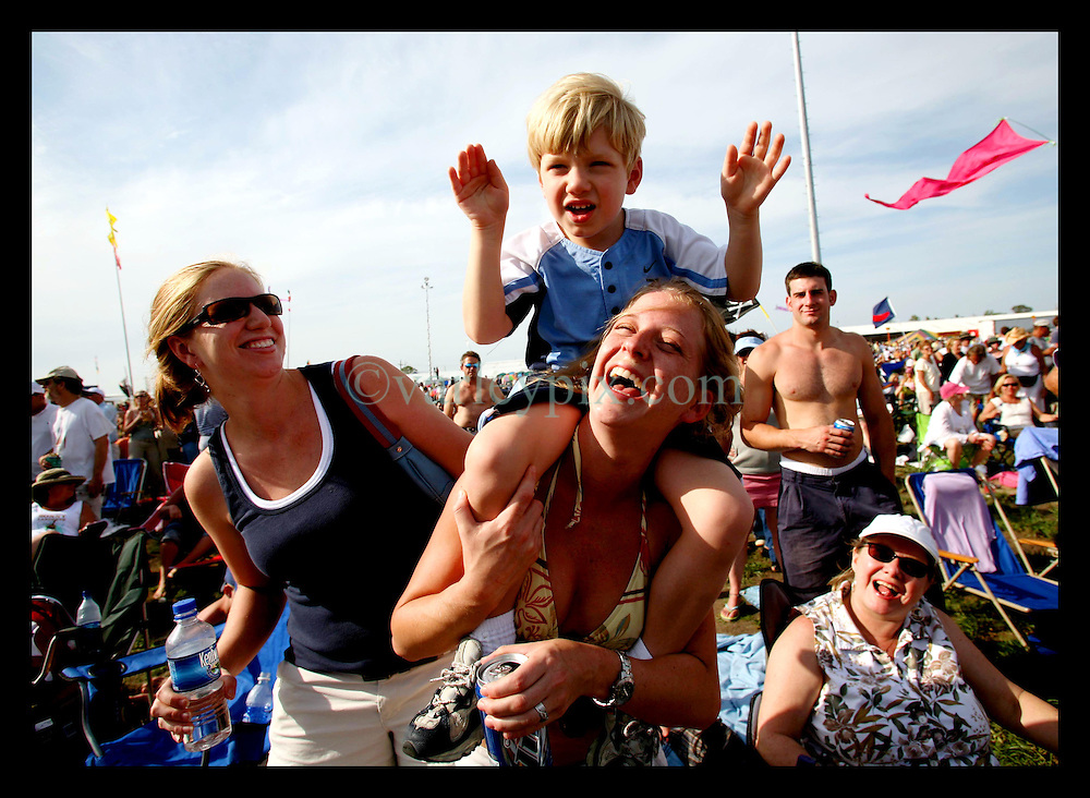 April 28nd, 2006. New Orleans, Louisiana. Jazzfest . The New Orleans Jazz and Heritage festival. 4 yr old Code Vagnier sits atop his aunt Jessica's shoulders as Bob Dylan plays on the first day of the festival at the Acura stage.