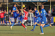 AFC Wimbledon defender Toby Sibbick (20) battles for possession with Charlton Athletic midfielder Tarique Fosu (11) during the EFL Sky Bet League 1 match between AFC Wimbledon and Charlton Athletic at the Cherry Red Records Stadium, Kingston, England on 23 February 2019.