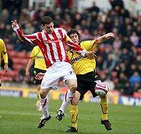 Photo: Mark Stephenson/Sportsbeat Images.<br /> Stoke City v Watford. Coca Cola Championship. 09/12/2007.Watrord's John Joe O'Toole battles with Stokes Roy Delap