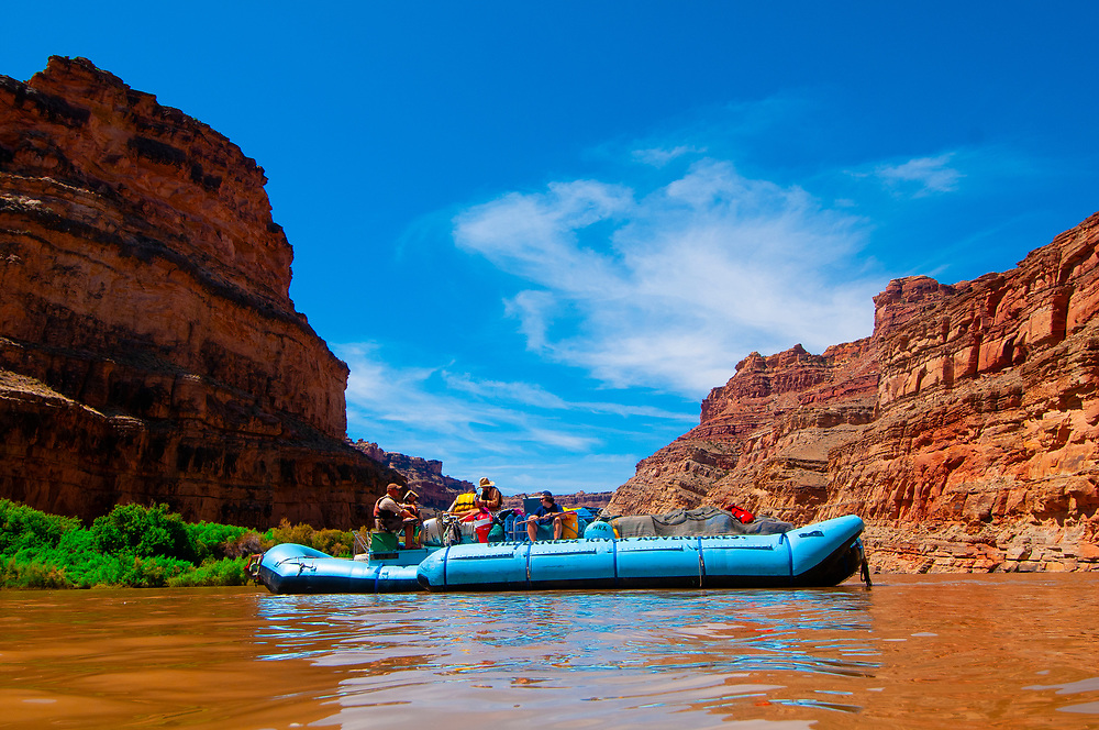 A Wilderness River Adventures motorized pontoon rafting down the Meander Canyon section of the Colorado River in Canyonlands National Park, Utah, USA.