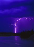 Lightning from a late summer thunderstorm over the Kluane River, Yukon Territory, Canada.