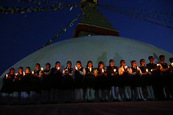 April 25, 2017 - Kathmandu, Nepal - Nepalese school students hold candles in front of the Boudhanath Stupa in remembrance and memory of those lives lost to mark the 2nd anniversary of the 2015 Nepal Earthquake in Kathmandu, Nepal. (Credit Image: © Skanda Gautam via ZUMA Wire)
