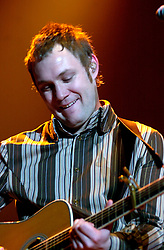 David Grey plays a Concert to a sellout Sheffield Hallam FM Arena  November 29 2002 Friday<br /><br />Copyright Paul David Drabble<br />Freelance Photographer<br />07831 853913<br />0114 2468406<br />www.pauldaviddrabble.co.uk<br /> [#Beginning of Shooting Data Section]<br />Nikon D1 <br /> 2002/11/29 21:58:07.2<br /> JPEG (8-bit) Fine<br /> Image Size:  2000 x 1312<br /> Color<br /> Lens: 80-200mm f/2.8-2.8<br /> Focal Length: 155mm<br /> Exposure Mode: Manual<br /> Metering Mode: Spot<br /> 1/125 sec - f/2.8<br /> Exposure Comp.: 0 EV<br /> Sensitivity: ISO 400<br /> White Balance: Auto<br /> AF Mode: AF-S<br /> Tone Comp: Normal<br /> Flash Sync Mode: Not Attached<br /> Color Mode: <br /> Hue Adjustment: <br /> Sharpening: Normal<br /> Noise Reduction: <br /> Image Comment: <br /> [#End of Shooting Data Section] David Grey plays a Concert to a sell out Sheffield Hallam FM Arena November 29 2002 Friday<br /> <br /> Copyright Paul David Drabble<br /> Freelance Photographer<br /> 07831 853913<br /> 0114 2468406