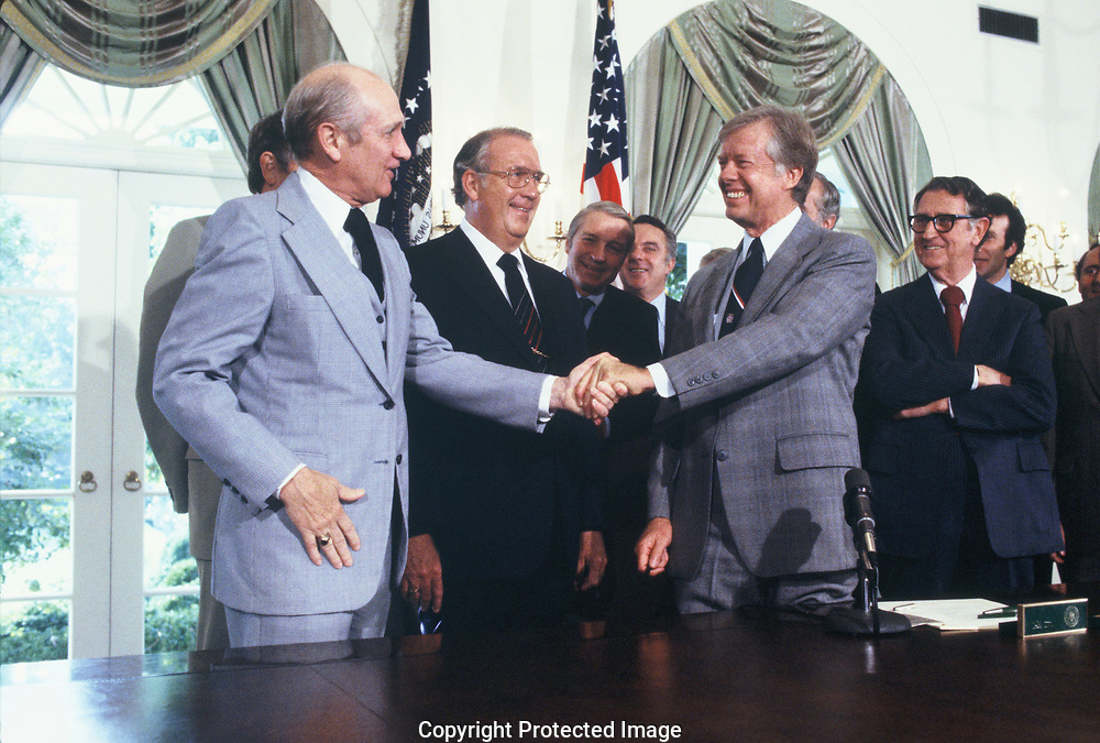 President Jimmy Carter signs the Inspector Generals Bill in November 1978 President Carter and Rep Jack Brooks<br /> Photo by Dennis Brack
