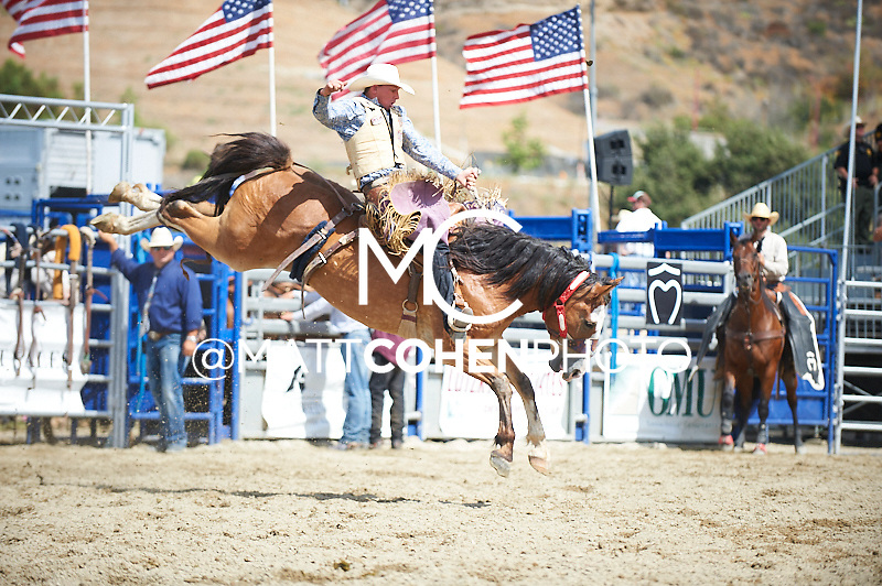 Saddle bronc rider Cody Taton of Corona, NM rides 300 Long Walk Home at the Rancho Mission Viejo Rodeo in San Juan Capistrano, CA.  <br /> <br /> <br /> UNEDITED LOW-RES PREVIEW<br /> <br /> <br /> File shown may be an unedited low resolution version used as a proof only. All prints are 100% guaranteed for quality. Sizes 8x10+ come with a version for personal social media. I am currently not selling downloads for commercial/brand use.