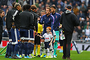 Tottenham Hotspur striker Harry Kane (10) and the Hotspur mascot greet the Watford FC players team during the Barclays Premier League match, Saturday, Oct. 19, in London, United Kingdom. The teams played to a 1-1 tie (Mtichell Gunn/Image of Sport)