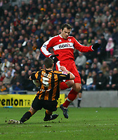 Photo: Andrew Unwin.<br />Hull City v Middlesbrough. The FA Cup. 06/01/2007.<br />Middlesbrough's Mark Viduka (R) is blocked by Hull's Danny Coles (L).
