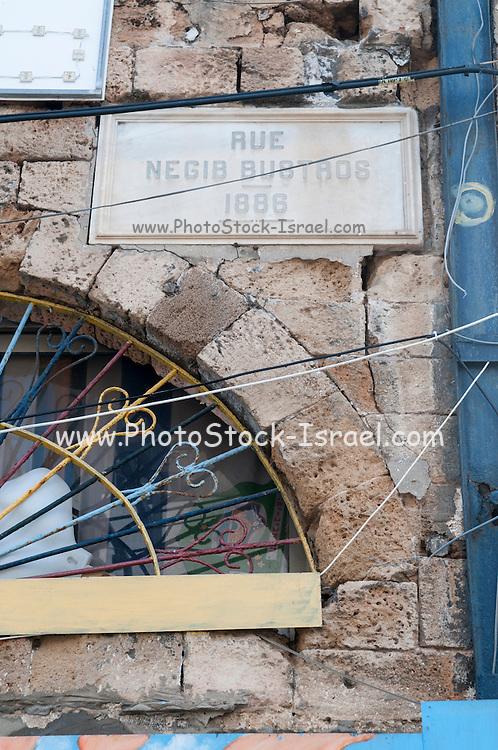 Israel Jaffa, an old stone street sign from 1886 Rue Negib Bustros. In 1948 after the Israeli capture of Jaffa the street was renamed to it's current name Raziel