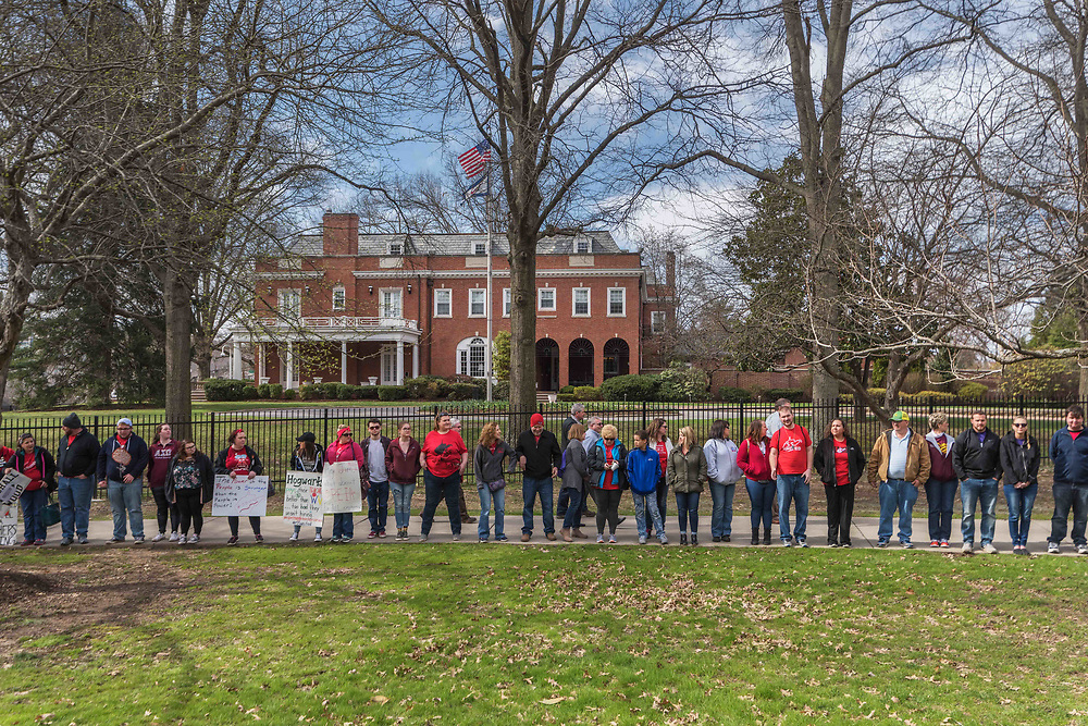 Teachers line the capitol grounds after the capitol was declared at capacity and admittance was temporarily on hold in Charleston, W.V., on Monday, March 05, 2018; the eighth day of statewide school closures.