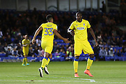 AFC Wimbledon striker Tom Elliott (9) congratulates AFC Wimbledon striker Lyle Taylor (33) equalise for AFC Wimbledon 2-2 during the EFL Cup match between Peterborough United and AFC Wimbledon at ABAX Stadium, Peterborough, England on 9 August 2016. Photo by Stuart Butcher.