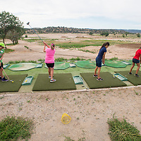 072313        Brian Leddy<br /> Participants in the Junior Golf class at Fox run golf Course hit balls on the driving range Tuesday July 23. The driving range platform has been reseeded, but the range itself is barren.