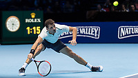 Tennis - 2017 Nitto ATP Finals at The O2 - Day Two<br /> <br /> Group Pete Sampras Singles: Dominic Thiem (Austria) Vs Grigor Dimitrov (Bulgaria)<br /> <br /> Grigor Dimitrov (Bulgaria) slips as he tries to reach the ball at the O2 Arena <br /> <br /> <br /> COLORSPORT/DANIEL BEARHAM