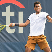 FELIX AUGER-ALLIASSIME hits a forehand at the Rock Creek Tennis Center.