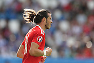 Gareth Bale of Wales looks on.  Euro 2016, Wales v Slovakia at Matmut Atlantique , Nouveau Stade de Bordeaux  in Bordeaux, France on Saturday 11th June 2016, pic by  Andrew Orchard, Andrew Orchard sports photography.