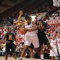 Rutgers Scarlet Knights forward/center Monique Oliver (44) grabs an offensive rebound away from West Virginia Mountaineers forward Madina Ali (44) during second half Big East NCAA women's basketball action during Rutgers' 67-58 victory over West Virginia at the Louis Brown Rutgers Athletic Center.