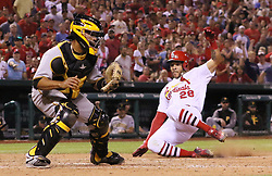 June 25, 2017 - St Louis, MO, USA - St. Louis Cardinals' Tommy Pham scores past Pittsburgh Pirates catcher Elias Diaz on a single by Yadier Molina in the seventh inning on Sunday, June 25, 2017, at Busch Stadium in St. Louis, Mo. (Credit Image: © Chris Lee/TNS via ZUMA Wire)