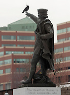 Newburgh, New York -  A crow uses the finger of a statue of Christopher Columbus as a perch by the Hudson River on Feb. 20, 2007.