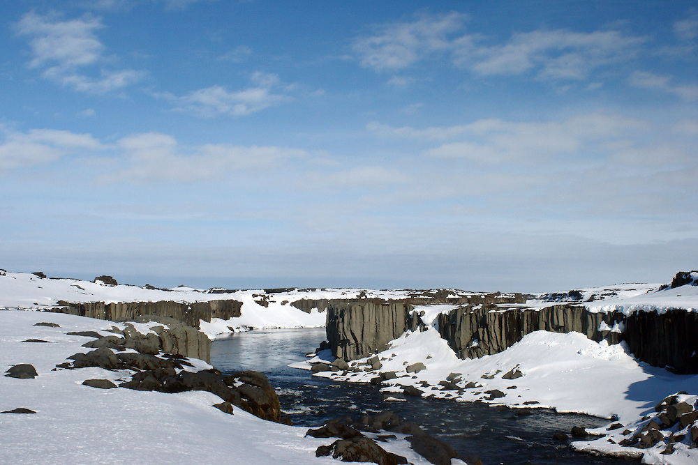 Basalt cliffs below the Selfoss Waterfall on the Jökulsá á Fjöllum river in the Vatnajökull National Park in northern Iceland in late March
