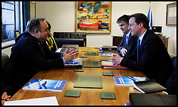 Scottish First Minister Alex Salmond meets British Prime Minister David Cameron and Michael Moore Scottish Secretary of State (far right) during talks on the Scottish Independence referendum in St Andrews House on February 16, 2012 in Edinburgh, Scotland. David Cameron said he would consider devolving further powers for Scotland if the Scottish people voted against independence in a referendum. Photo By Andrew Parsons/ i-Images