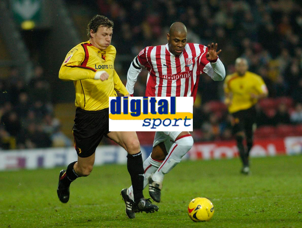 Photo: Leigh Quinnell.<br /> Watford v Stoke City. Coca Cola Championship.<br /> 14/01/2006. Watfords Darius Henderson clashes with Stokes Michael Duberry.