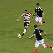 United States Forward Landon Donovan (10), Charlie Mulgrew (3) and Andy Wesbster (4) during an international friendly soccer match between Scotland and the United States at EverBank Field on Saturday, May 26, 2012 in Jacksonville, Florida.  The United States won the match 5-1 in front of 44,000 fans. (AP Photo/Alex Menendez)